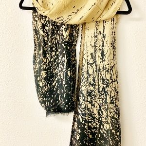 Black and cream scarf with sequins.
